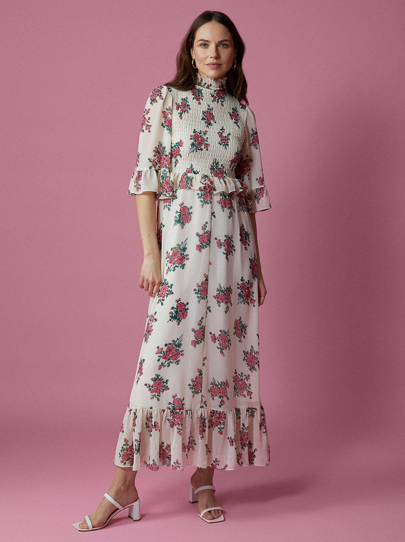 Girl wearing a white and pink floral dress