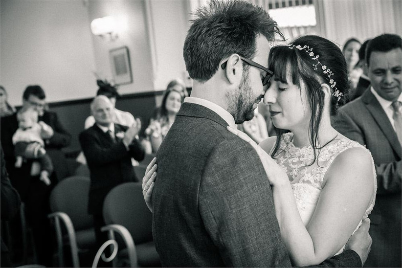 bride-and-groom-sharing-an-emotional-moment-post-ceremony-2