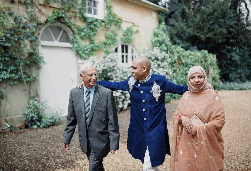Groom walks with his parents