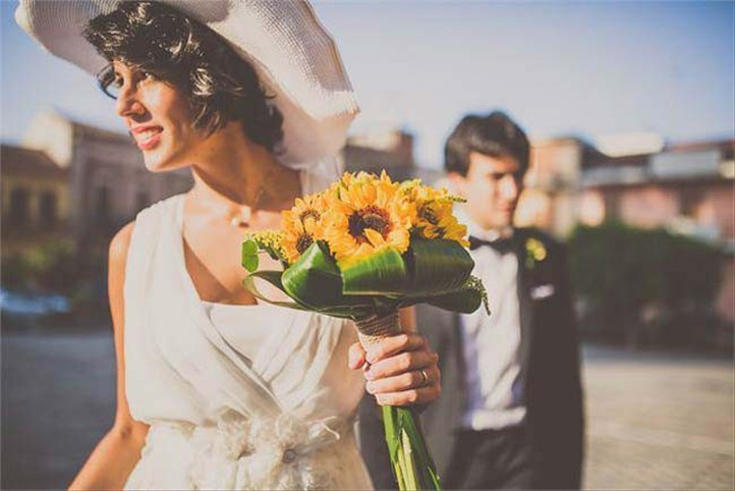 a-small-sunflower-bouquet-is-a-stylish-way-to-do-summer-wedding-flowers