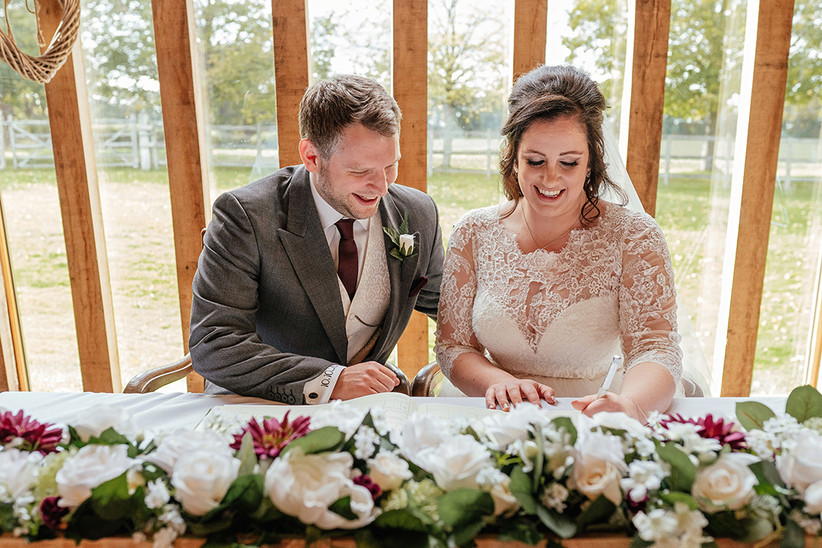 Ben and Becky signing the register