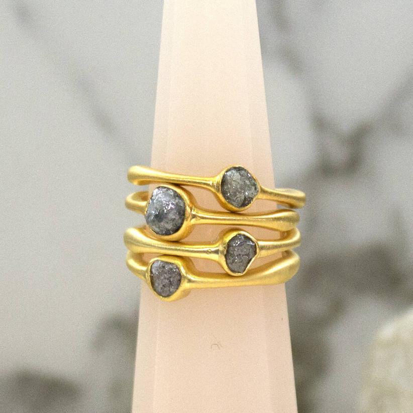 Three stacking gold rough diamond rings