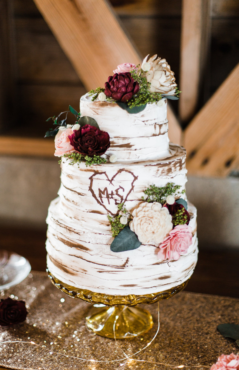 Three tiered birch inspired rustic wedding cake with flowers and initials