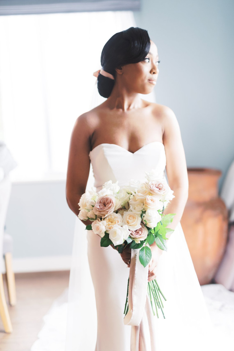 Bride face-on holding a bouquet