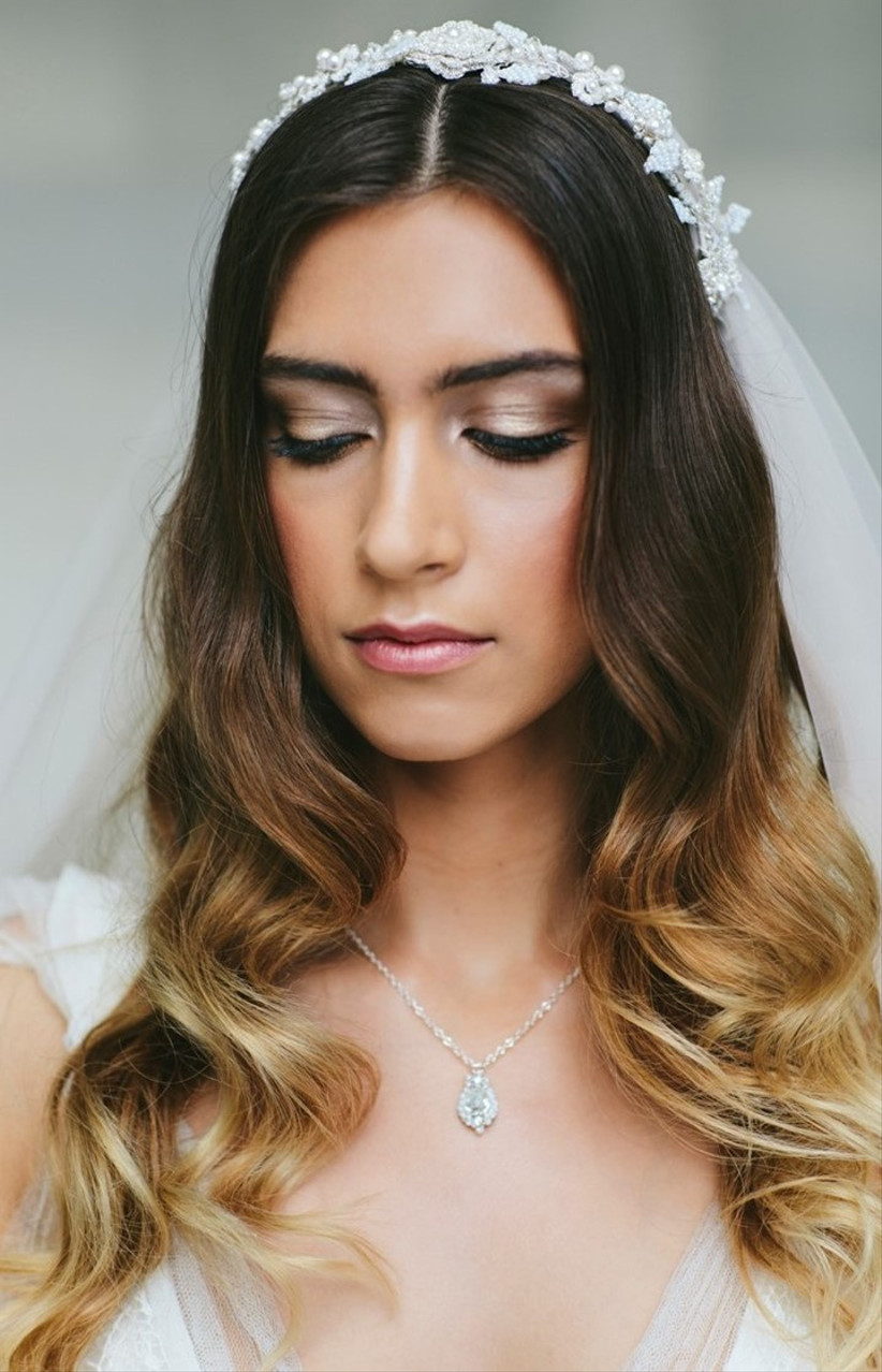 Bride with a veil looking down