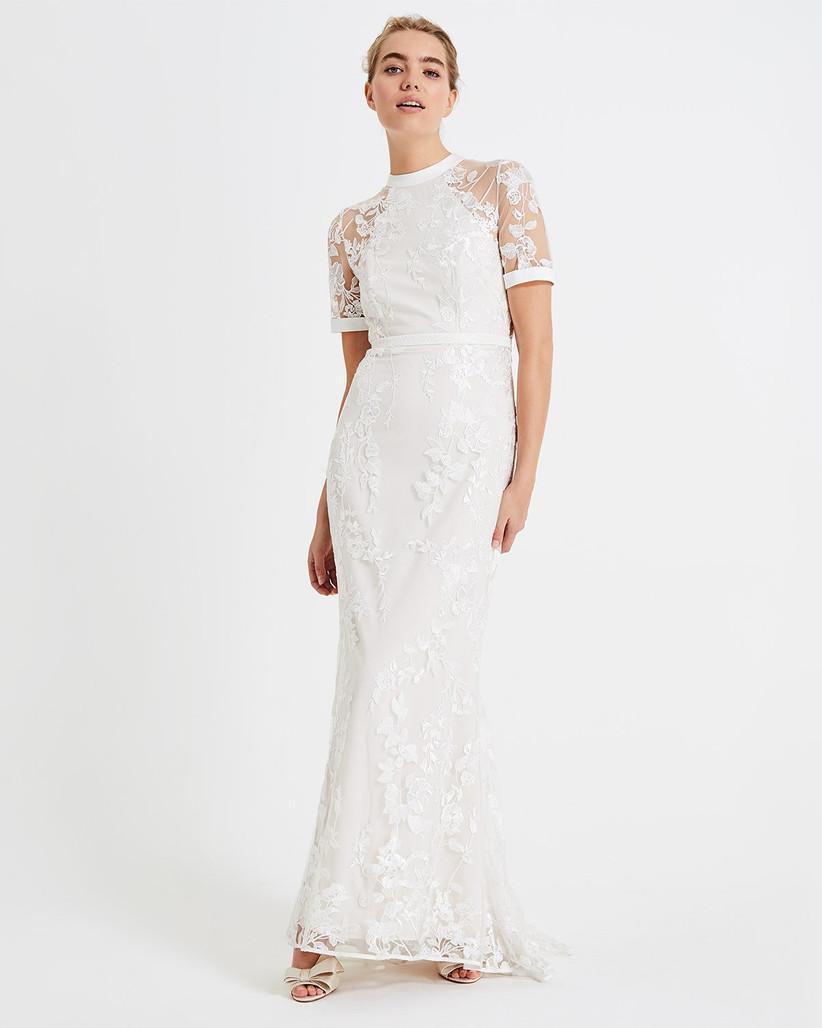 Girl wearing a t-shirt style lace white wedding dress