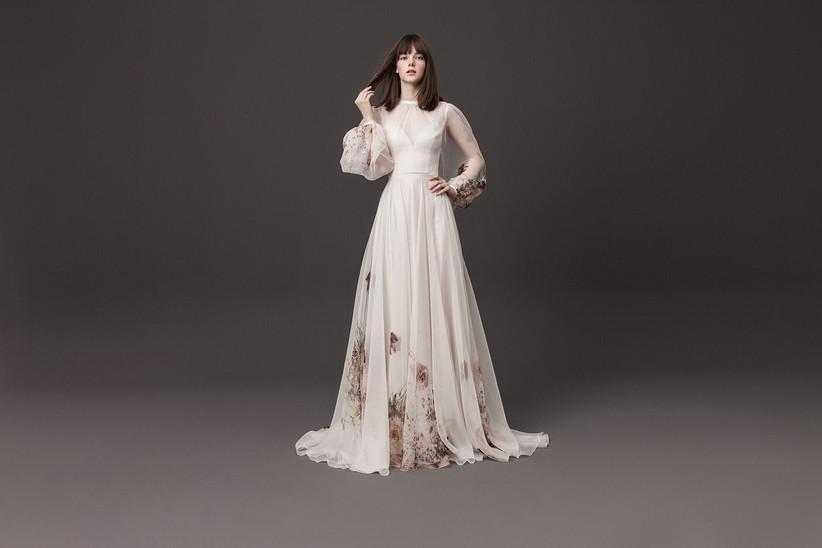 Model wearing a floral pattern sheer long sleeved wedding dress