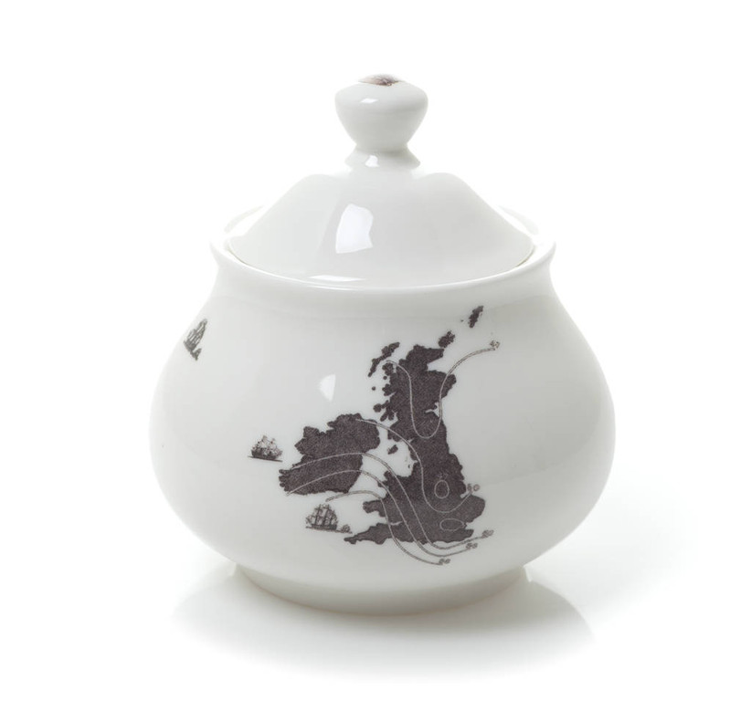 White sugar bowl with a country design