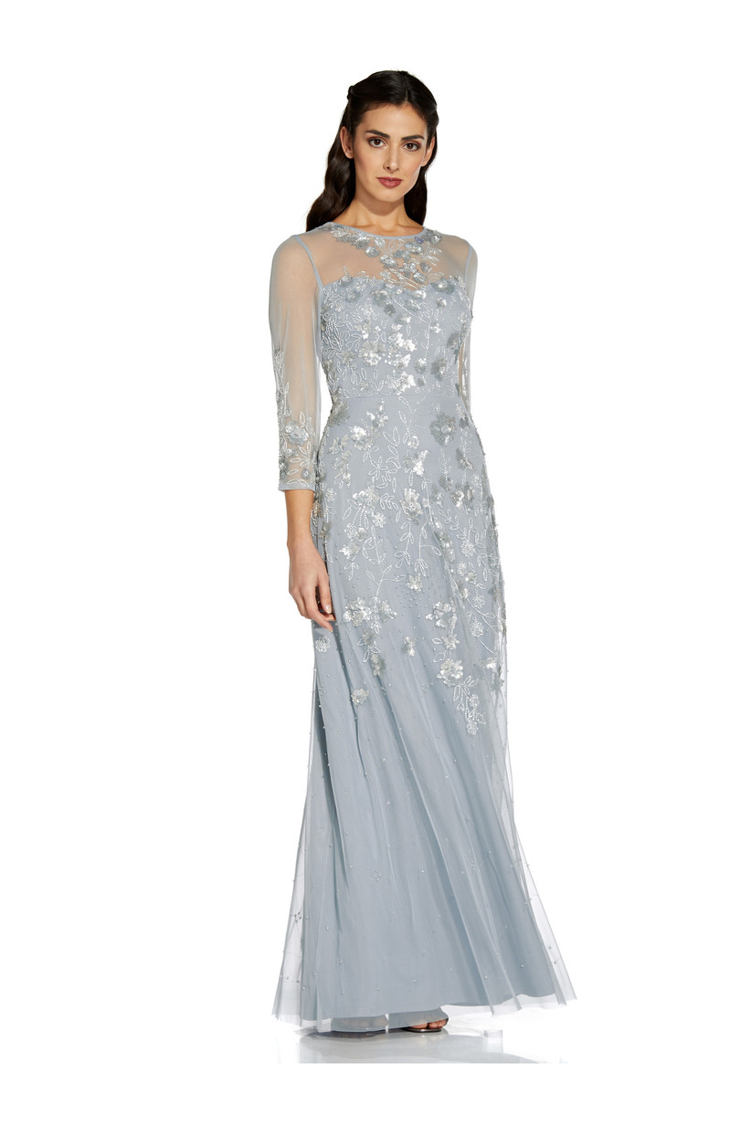 Girl wearing a ice blue sequins maxi dress