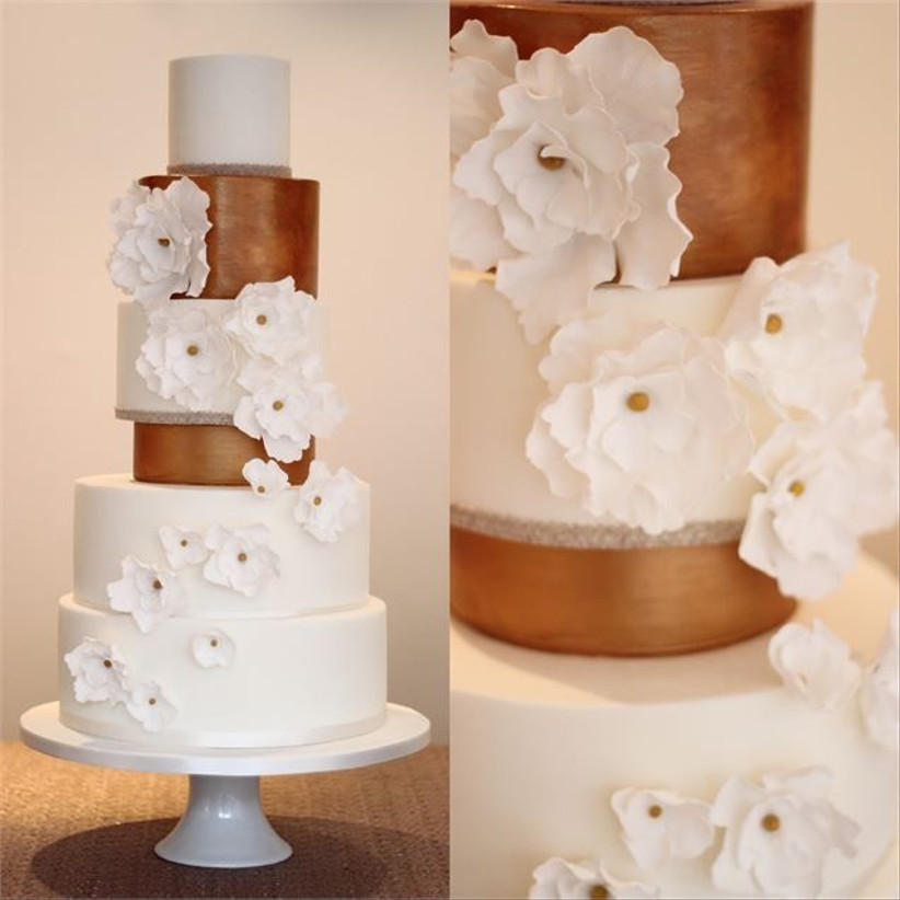 traditional-wedding-cake-with-rose-gold-tiers-and-floral-detail
