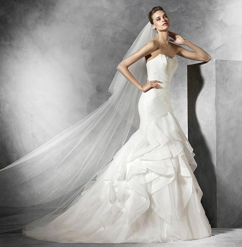 simple-wedding-dress-with-feathered-bodice-detail