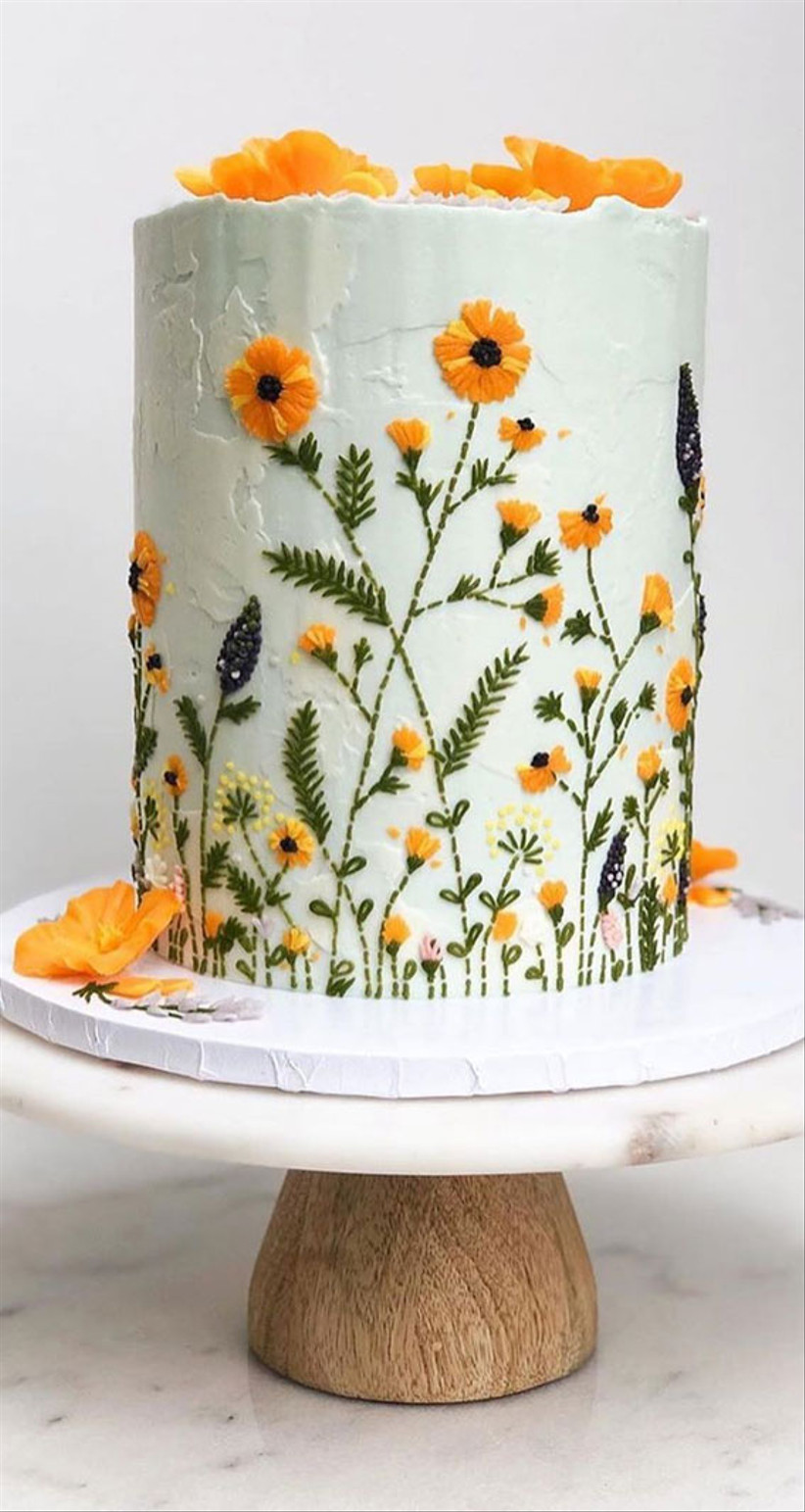 One tier white rustic wedding cake with yellow embroidery effect flowers