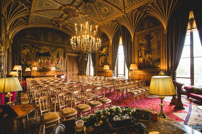 Ceremony room with draping curtains and oil paintings