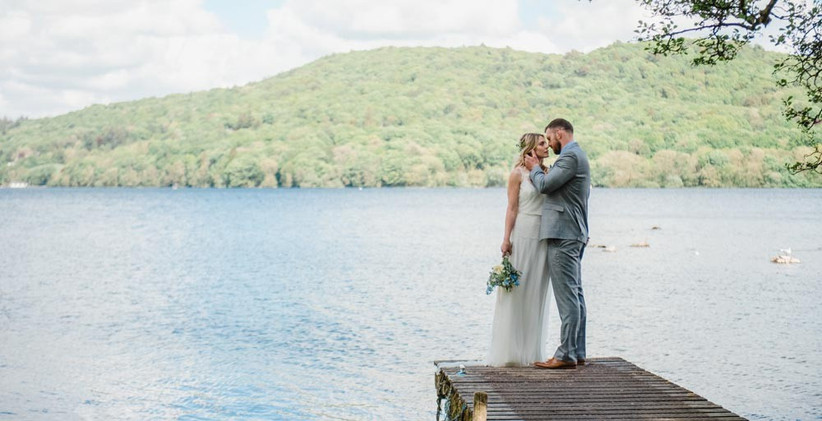 bride-and-groom-kissing-by-lake-2