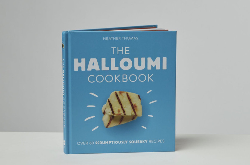 Small Halloumi Cookbook with a bright blue cover and photo of halloumi cheese on the front