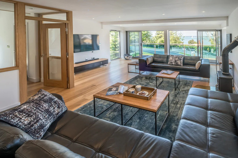 Living area with tables and a view out to the sea