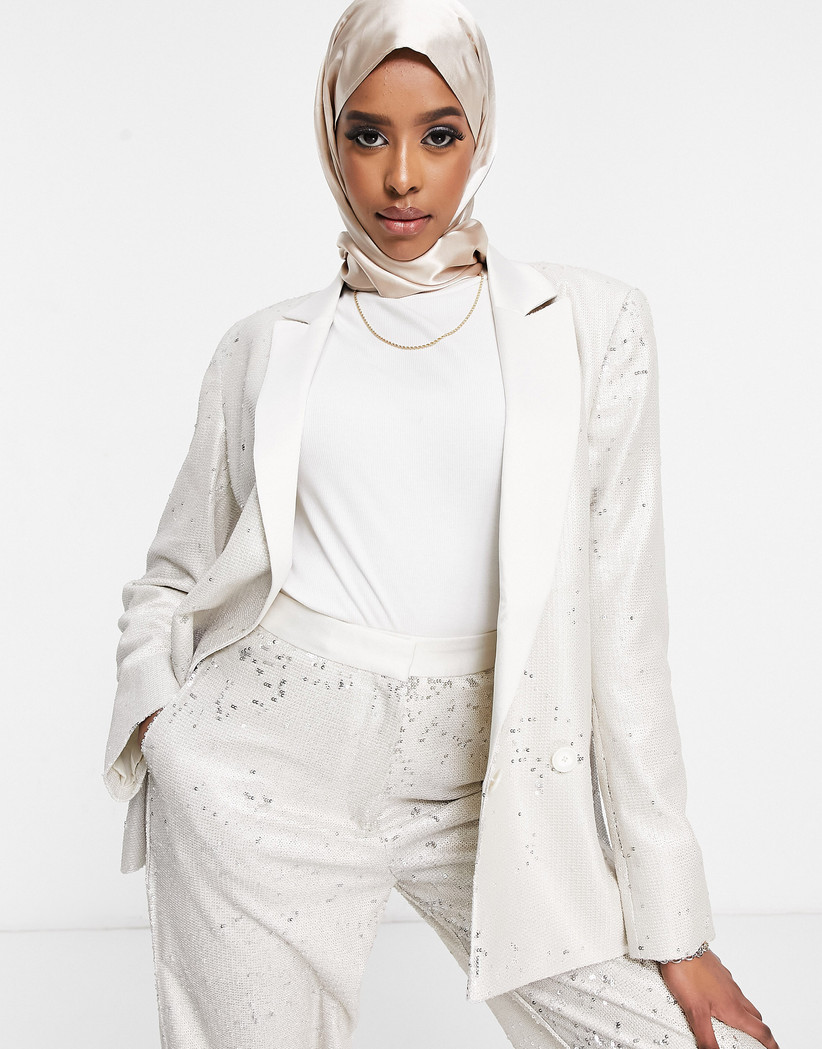 Girl wearing a white suit with sequins scattered