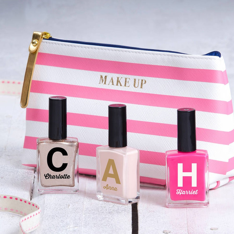 Pink striped makeup bag with personalised nail polishes