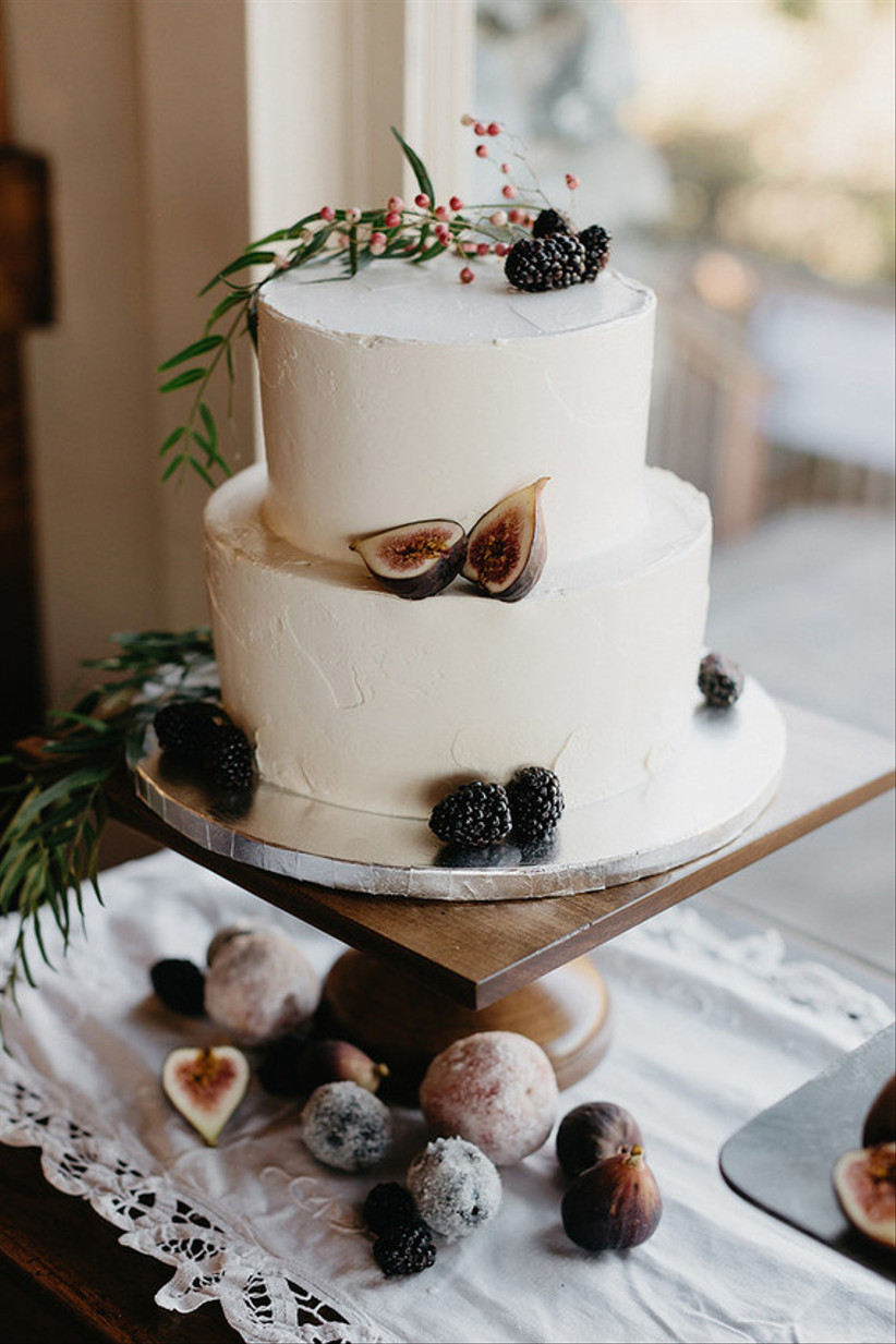 White two tiered rustic wedding cake with figs