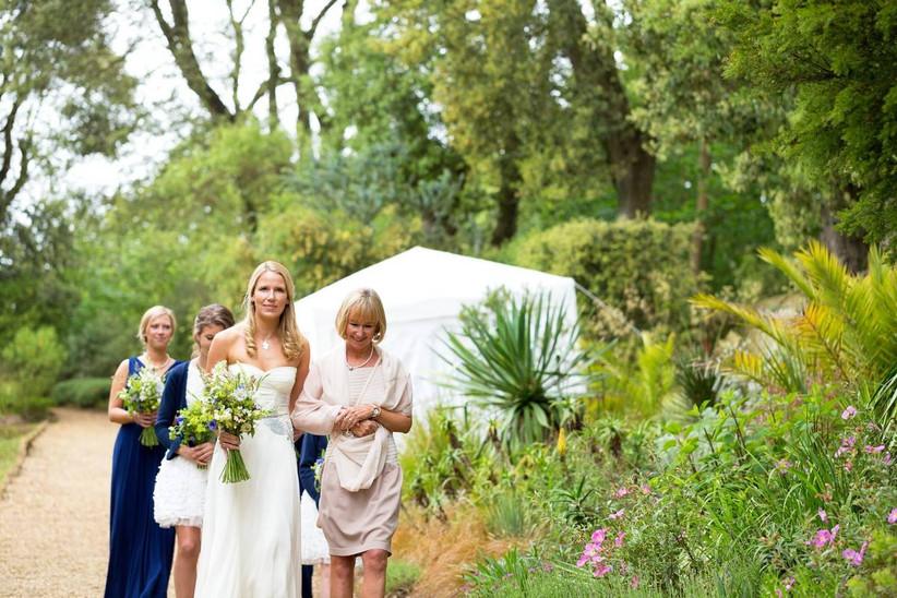 Bride and bridesmaids walk in a tropical garden