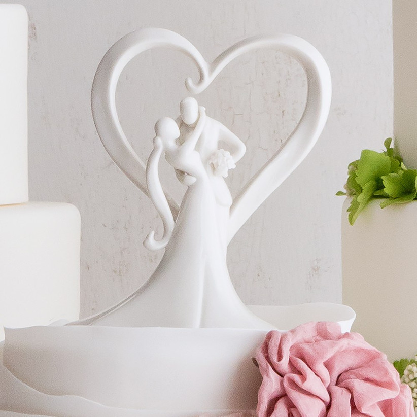 white structured heart and models wedding cake topper