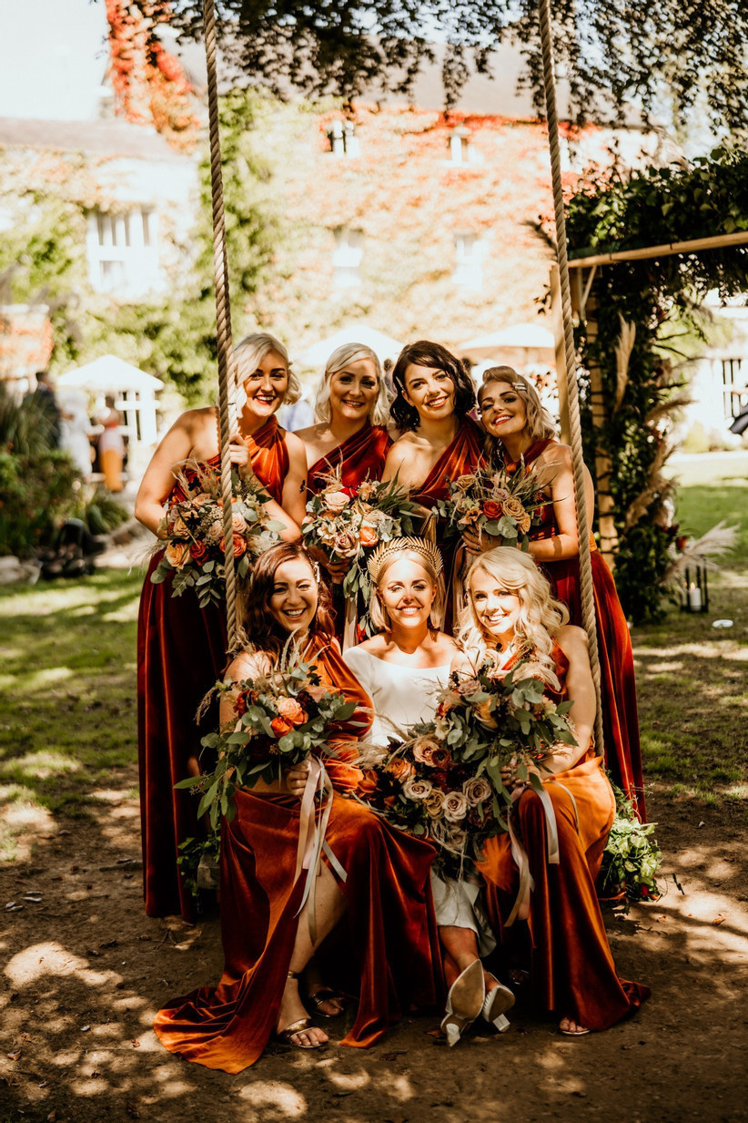 Bride surrounded by her bridesmaids