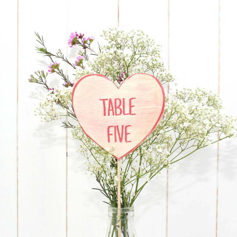 this-beautiful-table-number-display-with-summer-wedding-flowers-could-double-up-as-a-centrepiece