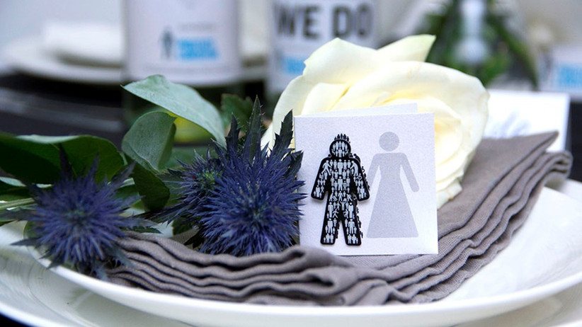 Charity wedding card on a napkin and thistles