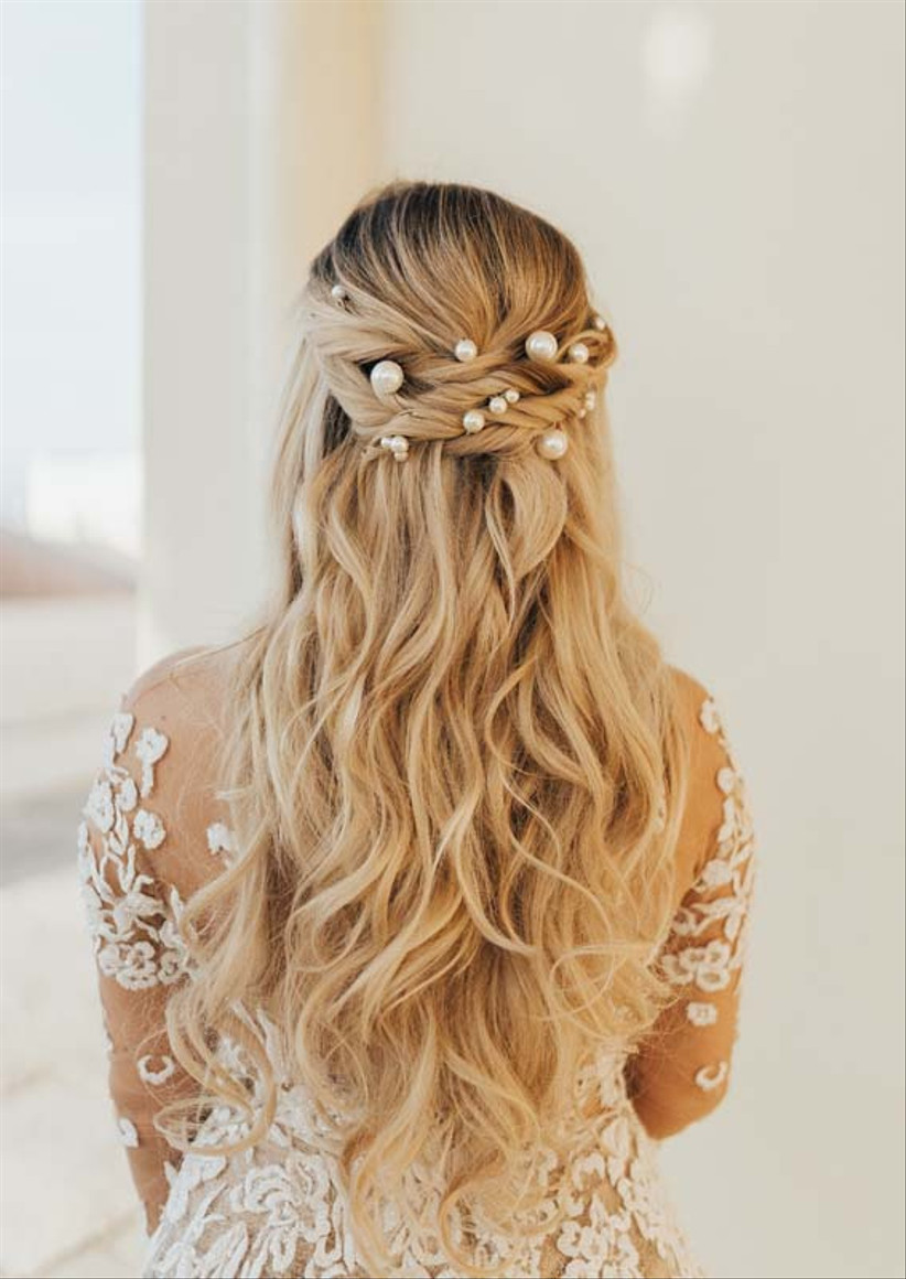 Half up half down twisted hairstyle with pearls