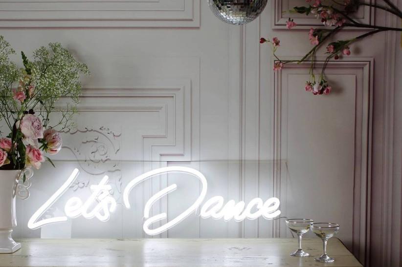 Neon let's dance anniversary sign