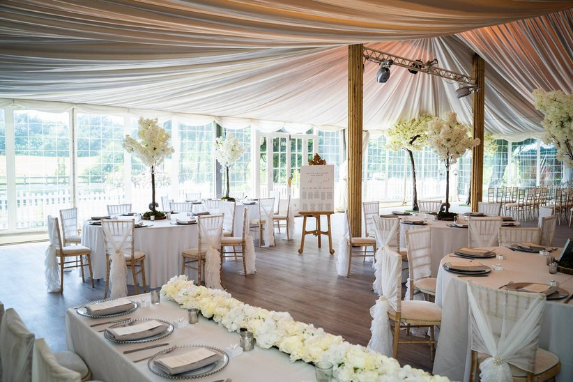 White marquee dining area with white floral trees