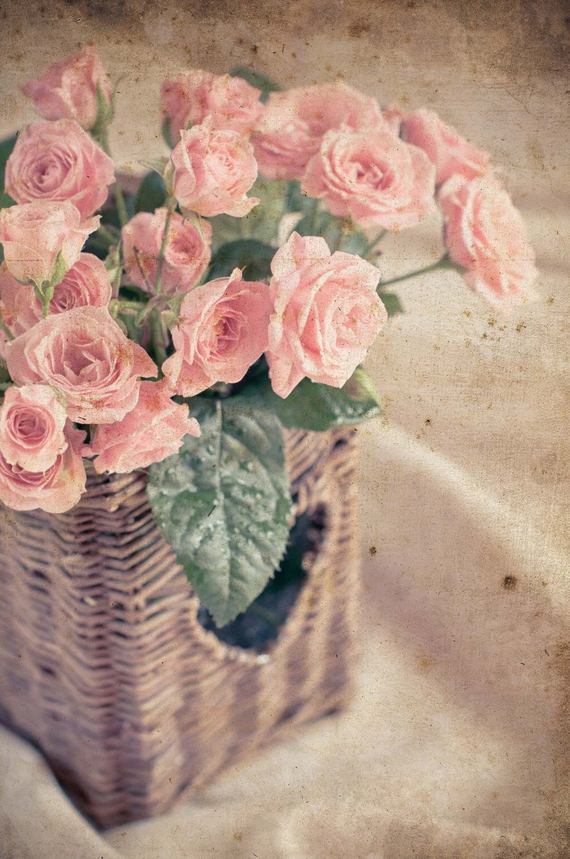 pink-roses-in-a-rustic-wicker-basket