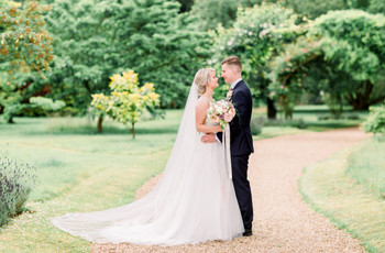 A Pretty, Pink Summer Wedding at Chippenham Park with a Horse-Drawn Carriage and a Stella York Dress