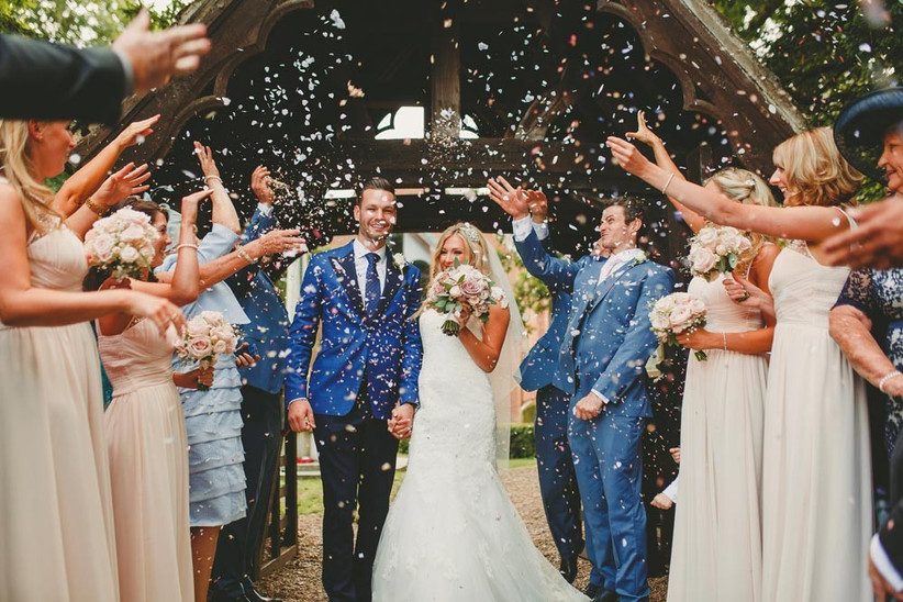 couple-getting-showered-with-confetti