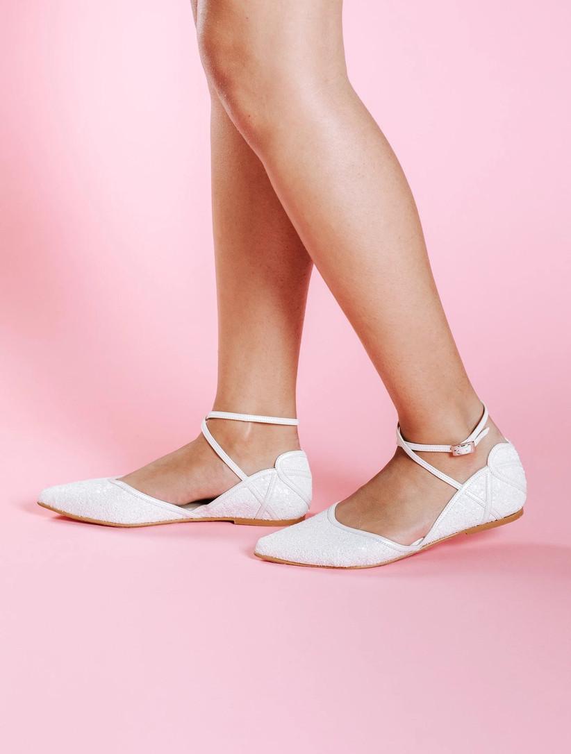 Model wearing white ballet bridal pumps