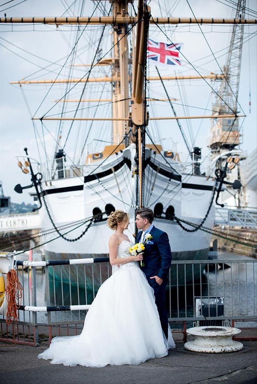 wedding-couple-in-front-of-boat-wedding-venue-hms-gannet