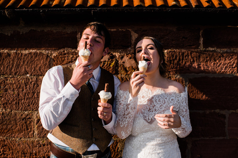 Caitlin and Stephen eating ice cream in their wedding outfits
