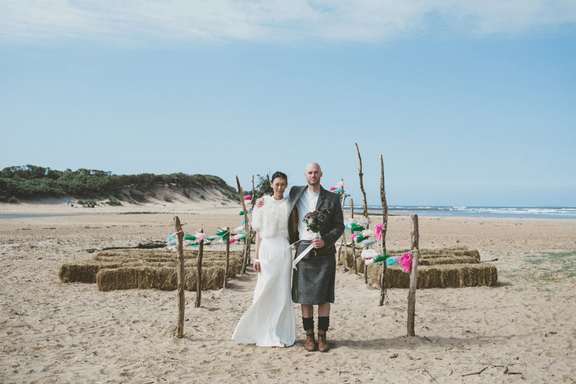 Bride and groom on the beach at outdoor wedding venue Harvest Moon