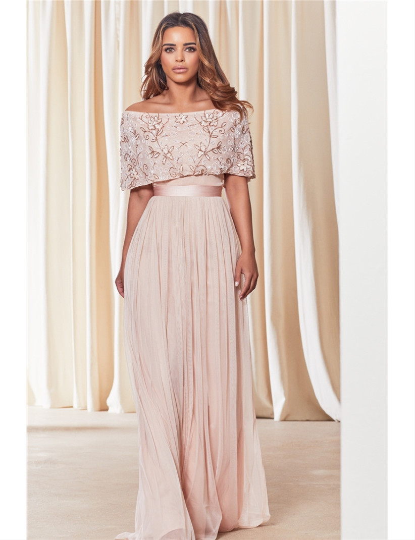 Girl wearing an off the shoulder embroidered pink maxi dress