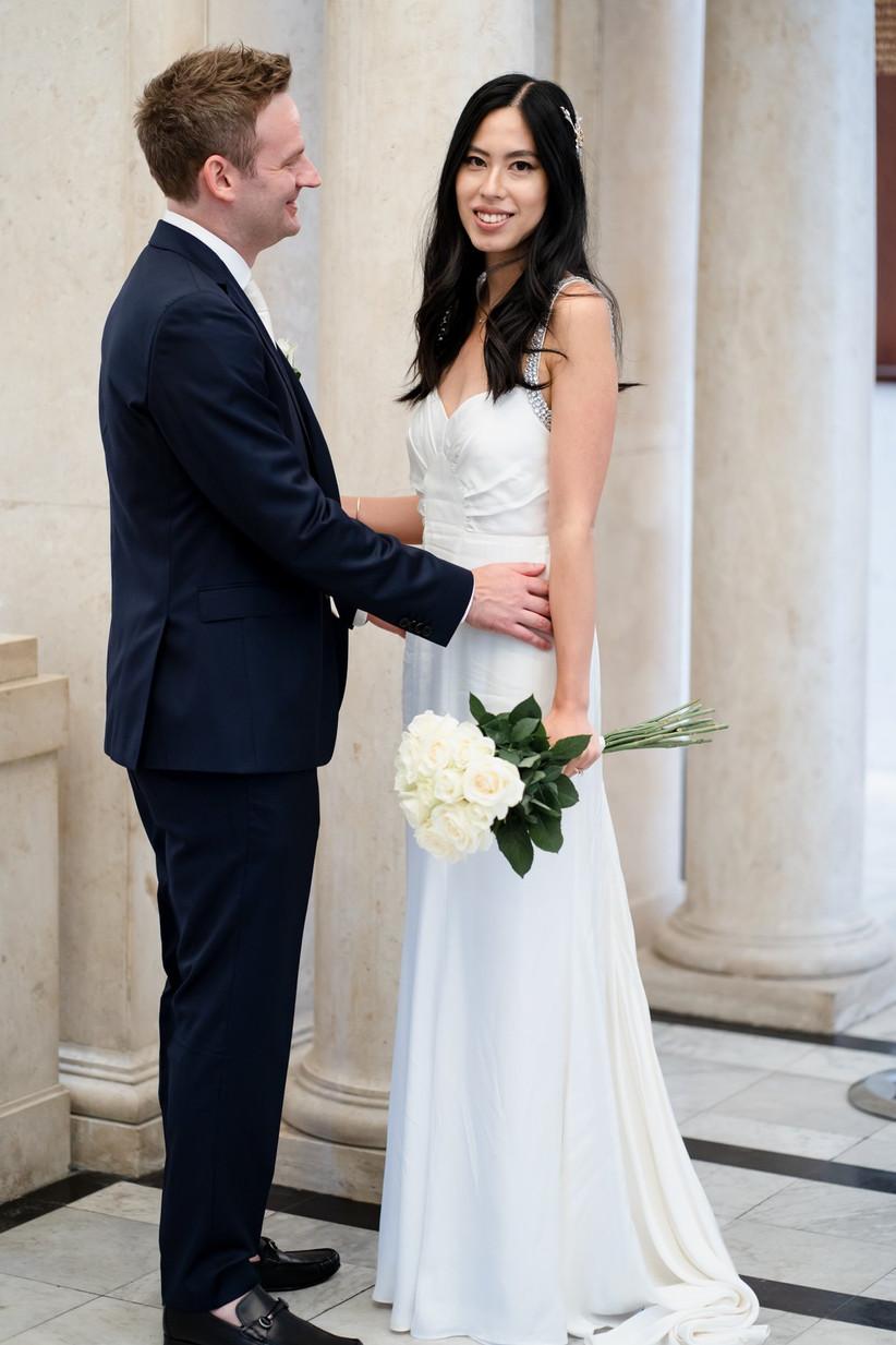 Groom gazing lovingly at bride