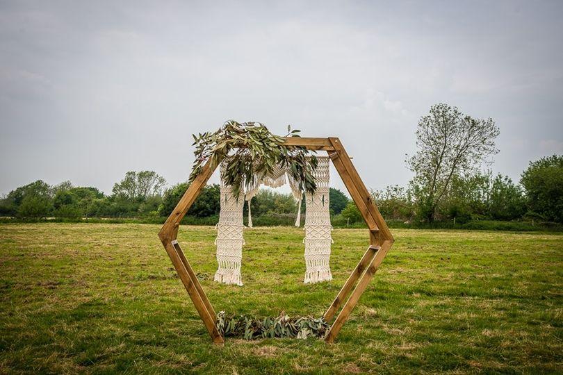 Rustic arch in field