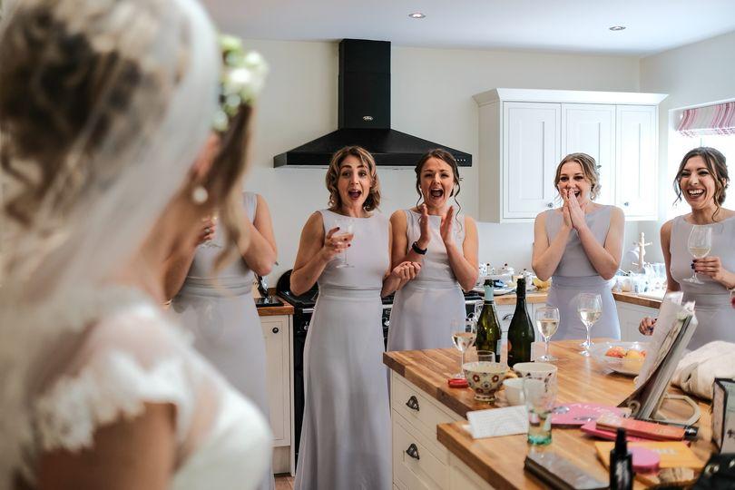 Bridesmaids see the bride