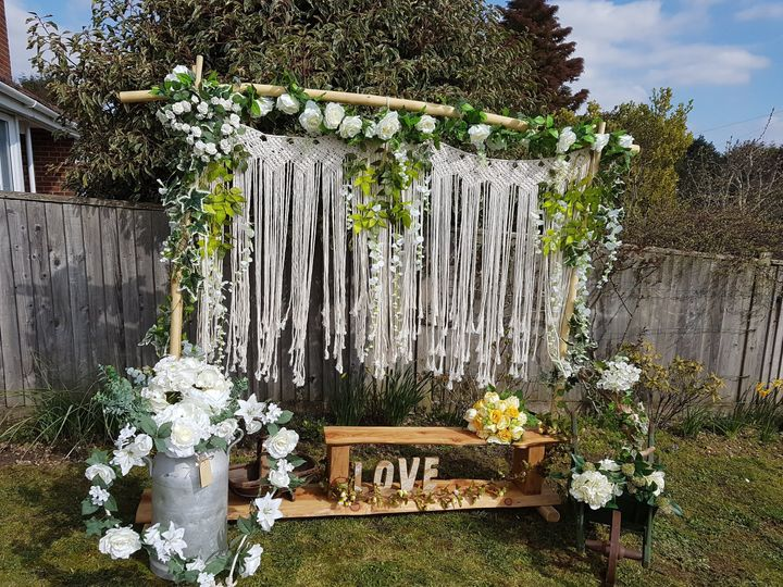 Rustic ceremony frame with florals