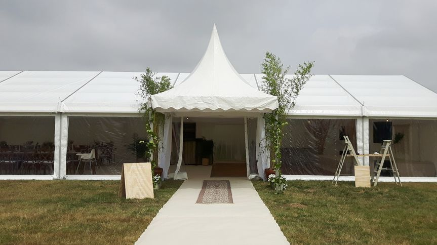 Marquee with retractable sides