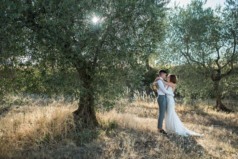 Couple standing beside a tree
