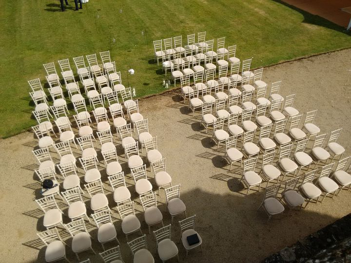 Seats set up for a ceremony under the Grand Portico