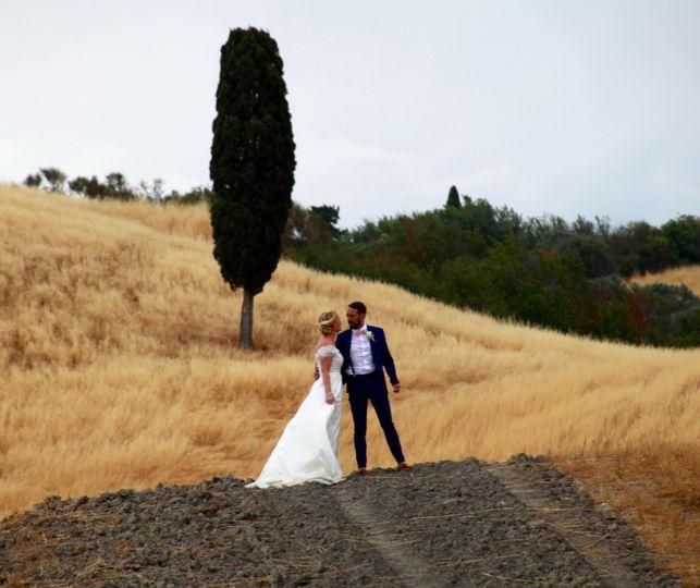 Couple in a field - Joanne Redington Photography