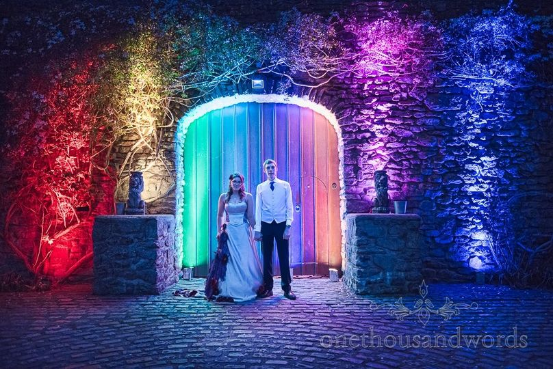 Uplit castle walls with weddign couple at night
