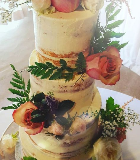 Naked scraped cake with flowers