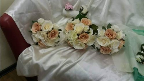 Ivory and peach silk roses